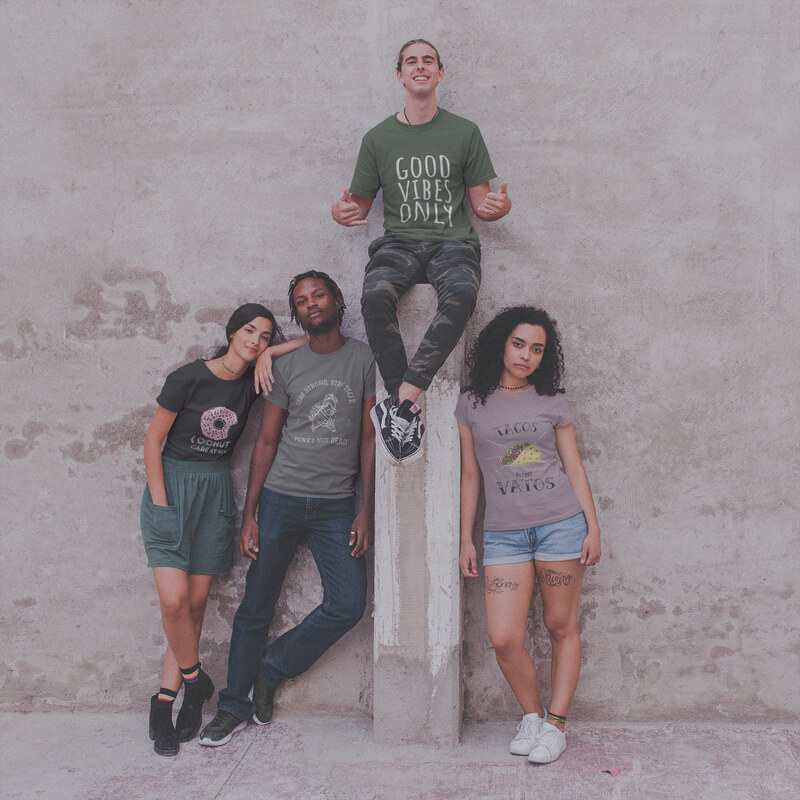 Four Teens Wearing Interracial T Shirts Mockup Against A Concrete Wall