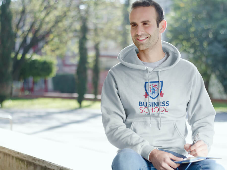 Male Student Sitting On A Bench At School Hoodie Mockup