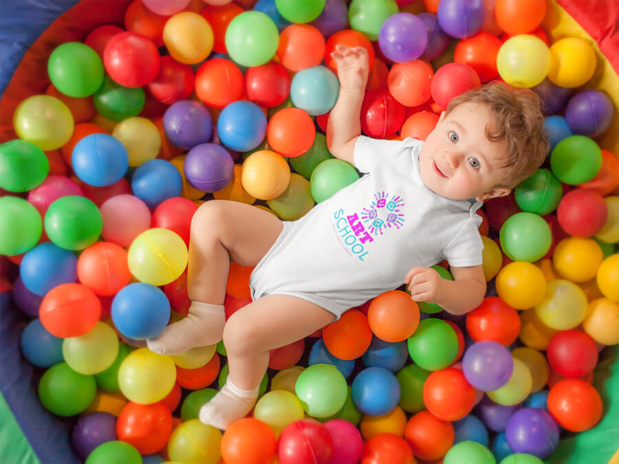 Mockup of Pretty Baby Having Fun At A Maternity Playground