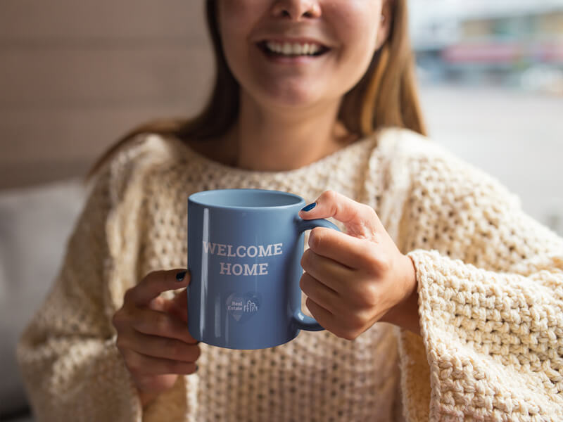 Coffee Cup Mockup of a Woman in Her Home for Real Estate