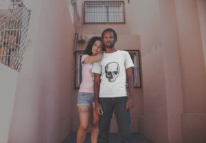 Young Couple Wearing T Shirts Mockup Outside Their Apartment
