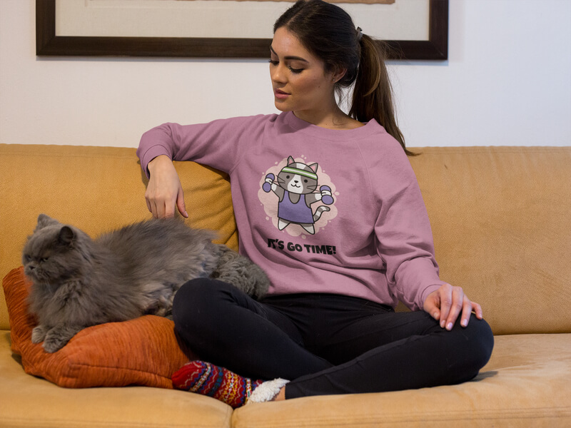 Beautiful Woman Wearing A Sweater Mockup With Her Grumpy Cat