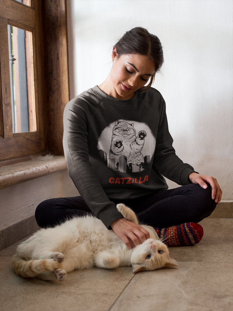 Woman Wearing A Crewneck Sweater While Her Cat Does Barrel Roll