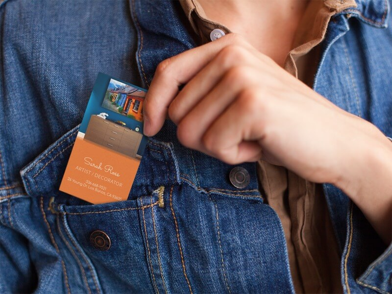 Woman Placing A Business Card In Her Jacket