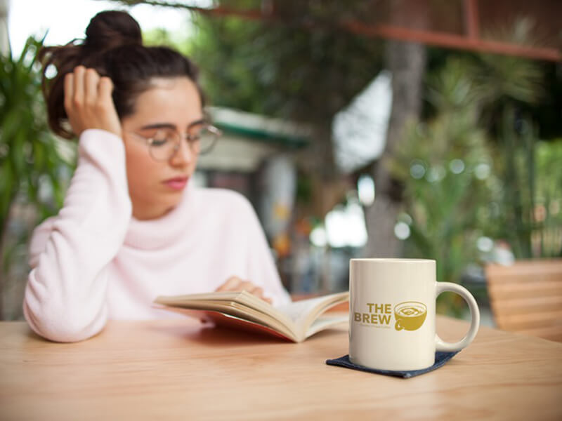 Coffee Shop Logo On A Mug Mockup