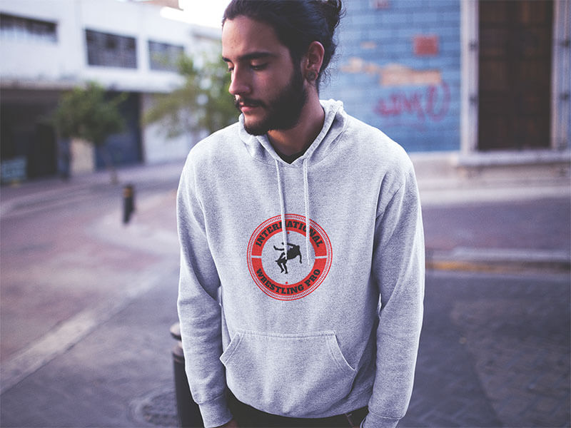 Hipster Man With Long Hair Wearing A Pullover Hoodie In A Downtown Street