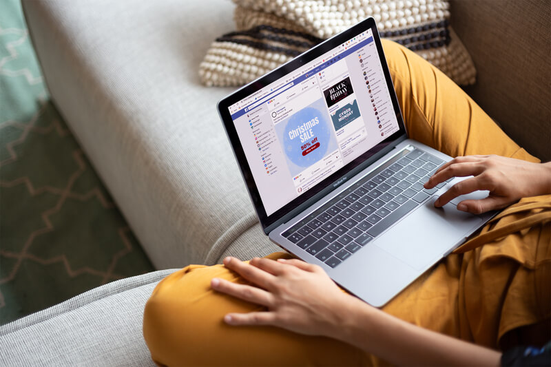 Woman Working With A Macbook Mockup Sitting On A Sofa