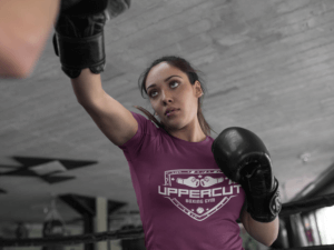 Woman Sparring At The Gym While Wearing Custom Sportswear Mockup