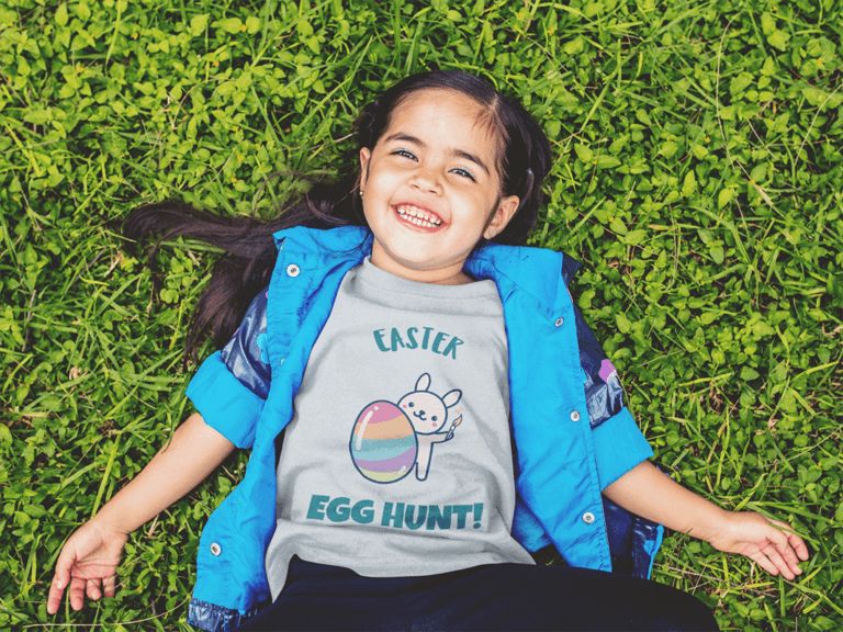 T Shirt Mockup Of A Little Girl Lying In The Grass Smiling A12099
