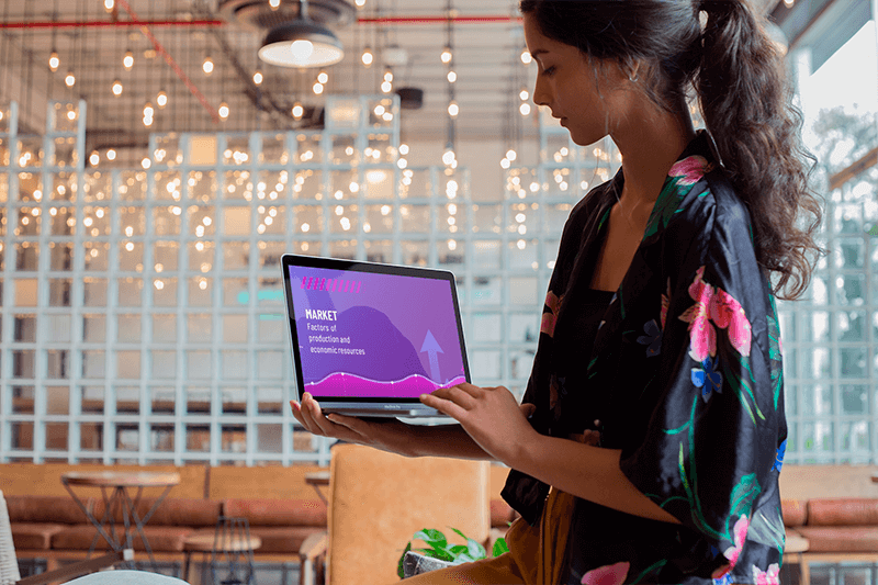 Woman Using A Macbook Mockup While Standing At A Startup A21169