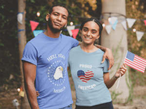 Smiling Black Man And Woman Wearing A Tshirt Mockup With A 4th Of July Design
