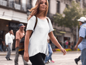 T Shirt Mockup Of A Hipster Woman Crossing The Street