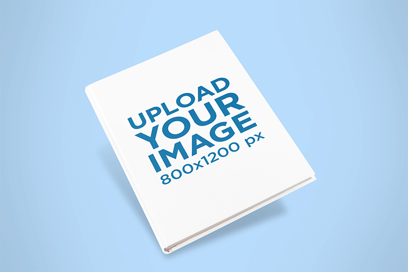 Mockup Of A Hardcover Book Angled Over A Colored Surface