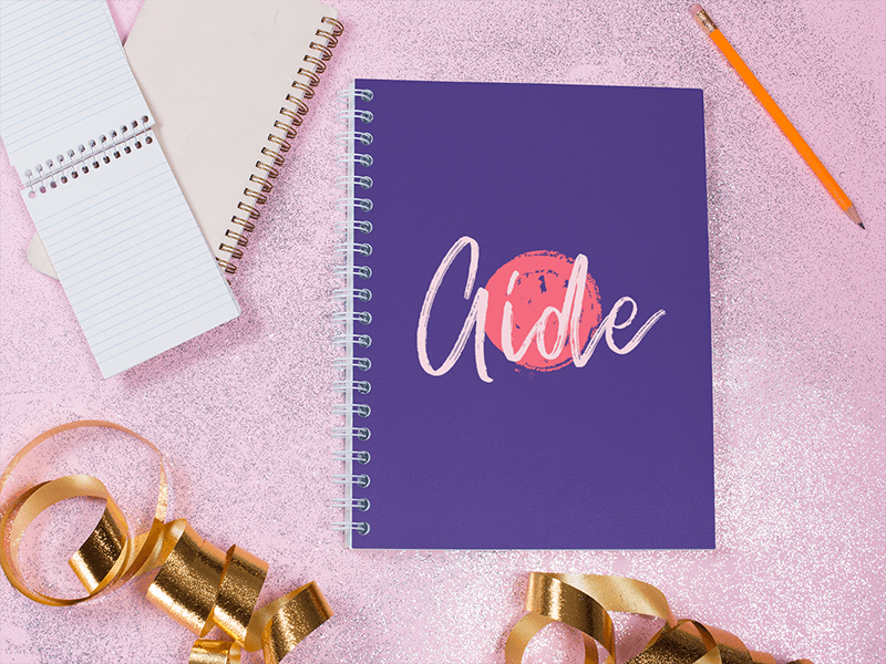Template Of A Spiral Notebook Lying On A Pink Surface Near Golden Ribbons And Smaller Notebooks