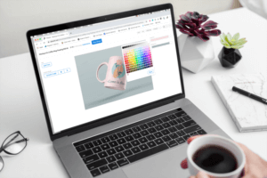 Macbook Pro Mockup On A White Desk Featuring Mug Design