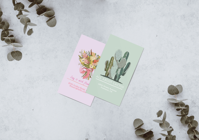 Minimal Mockup Featuring Two Business Cards Lying On A Grey Surface By Some Plants