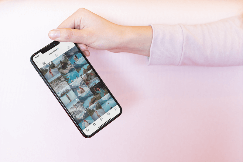 Mockup Of A Woman Holding An Iphone 11 Pro Featuring An Instagram Feed
