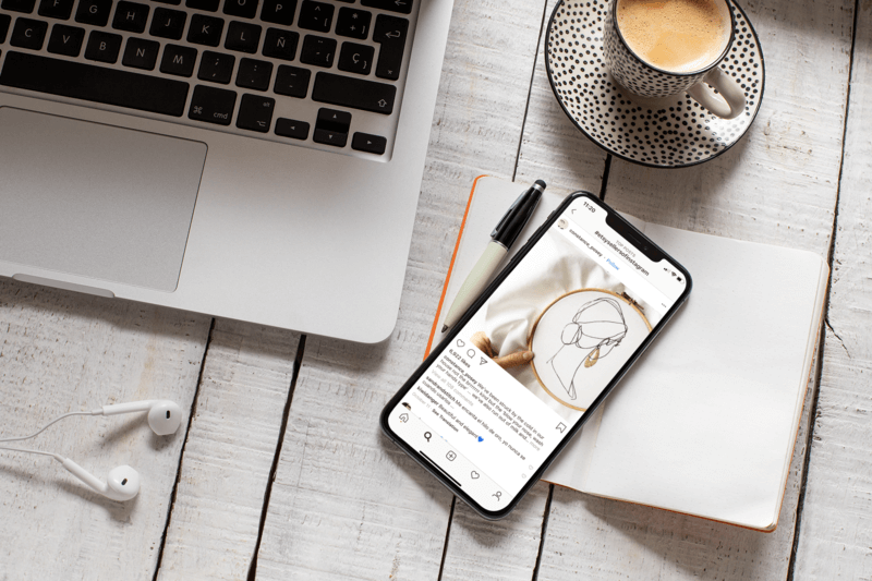 Iphone 11 Pro Mockup Featuring A Coffee Shop Setting
