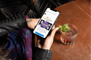 Iphone 11 Pro Mockup Featuring A Woman Having A Cocktail