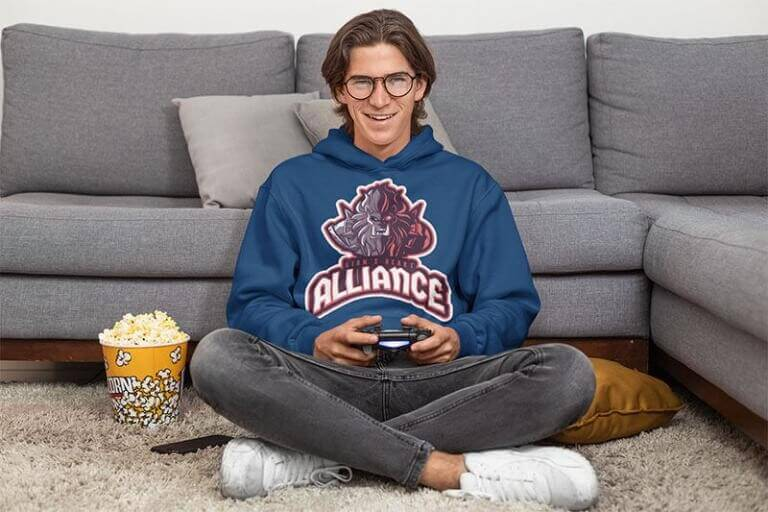 Pullover Hoodie Mockup Of A Man Playing Videogames At Home With A Popcorn Bucket