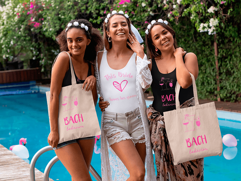 Tote Bag Mockup Of A Group Of Women Wearing Swimsuits At A Bachelorette Party