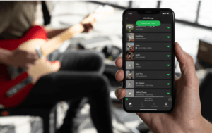 Iphone 11 Pro Mockup Featuring A Man Playing Guitar