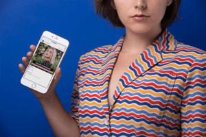 Gold Iphone 8 Mockup Of A Young Woman In A Colorful Striped Shirt