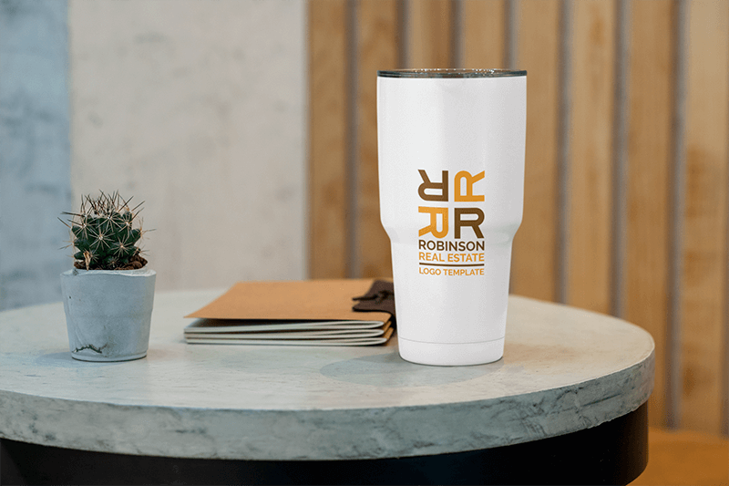 Mockup Of A 30 Oz Travel Mug On A Concrete Table