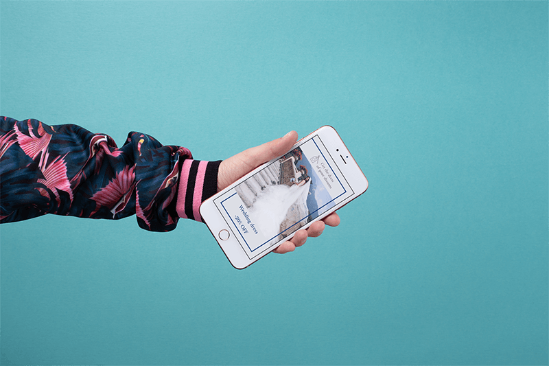 Mockup Of A Colorfully Dressed Arm Holding A Gold Iphone