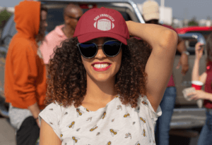 Dad Hat Mockup Of A Curly Haired Woman At A Tailgate Party