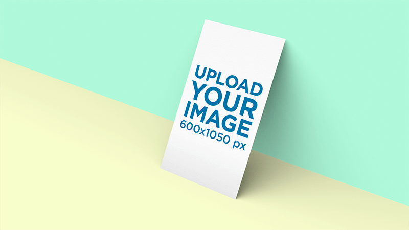 Business Card Mockup Standing Against A Two Color Background