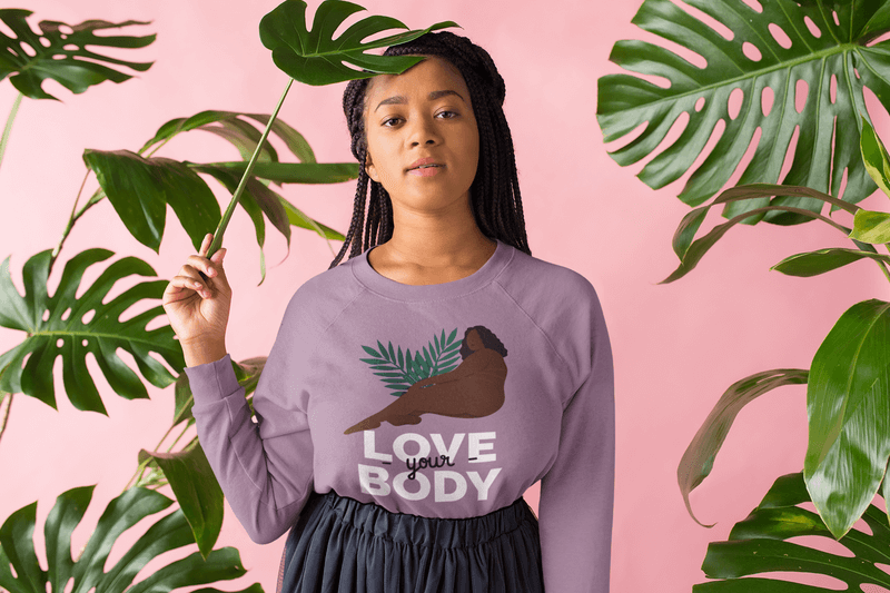 Crewneck Sweater Mockup Of A Girl With Braids Standing By Leaves
