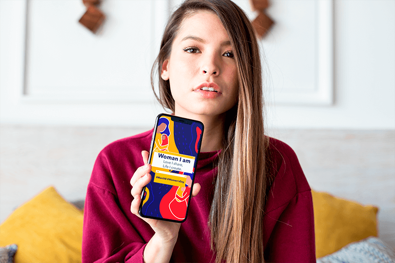 Mockup Featuring A Cute Blonde Girl Showing Off Her Iphone Xs