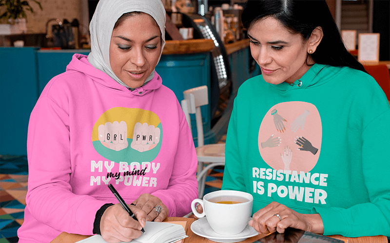 Pullover Hoodie Mockup Featuring Two Women Working Together At A Restaurant
