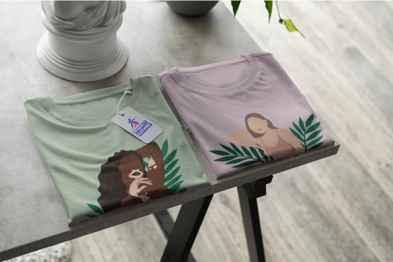 Mockup Of A Pair Of Folded Tees In A Store With A Price Tag