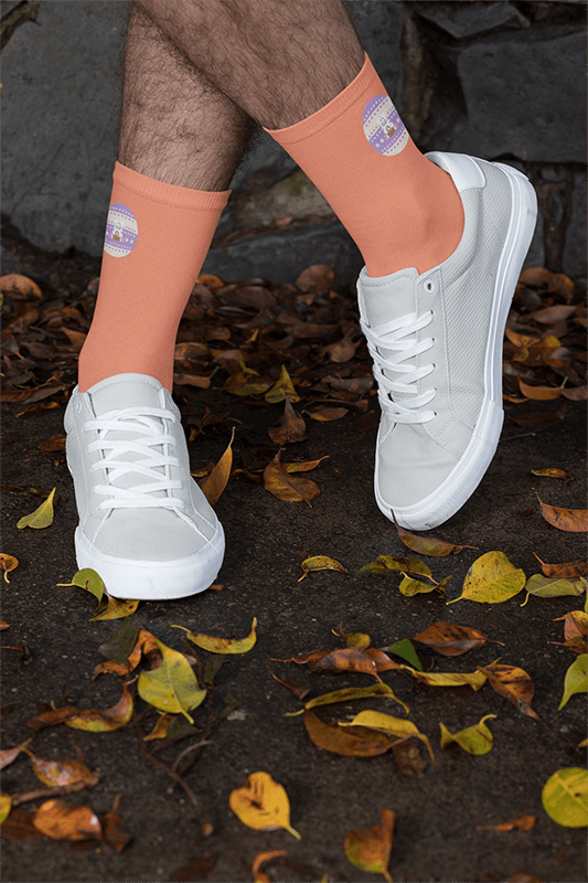 Socks Mockup Featuring A Man With Crossed Legs By Some Fall Leaves