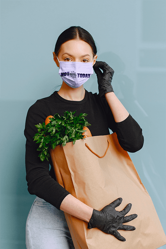 Face Mask Mockup Of A Woman Carrying A Bag Of Groceries