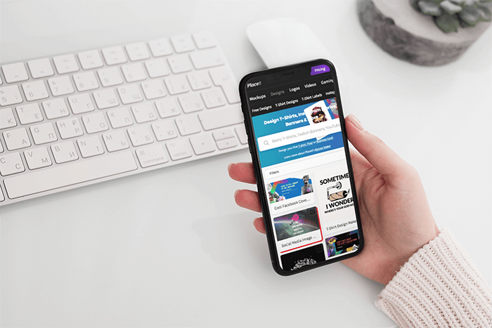 Mockup Featuring A Woman S Hand Holding An Iphone 11 Pro Over A Neat Desk