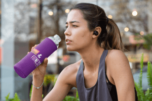 Mockup Of A Fit Woman Drinking From A Bottle In A Koozie