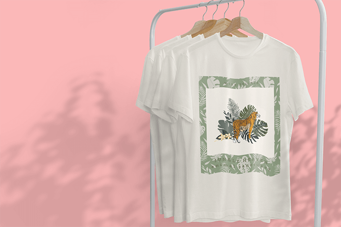 Mockup Of A Hanging T Shirt Featuring Tree Shadows In The Background