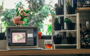 Mockup Of A Macbook Air Next To Some Plant Pots
