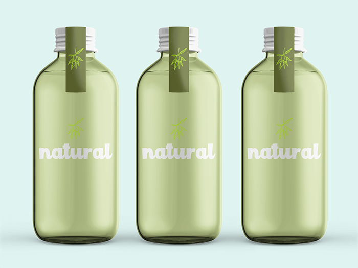 Mockup Of Three Glass Water Bottles In A Plain Setting