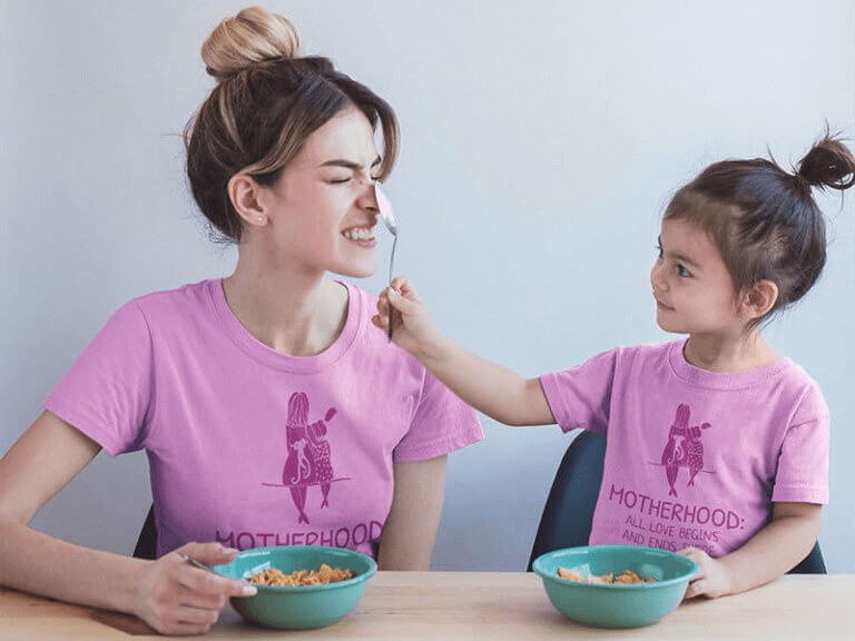 Mom And Daughter Wearing T Shirts Mockup During A Fun Breakfast A20283 Copy 768x1024