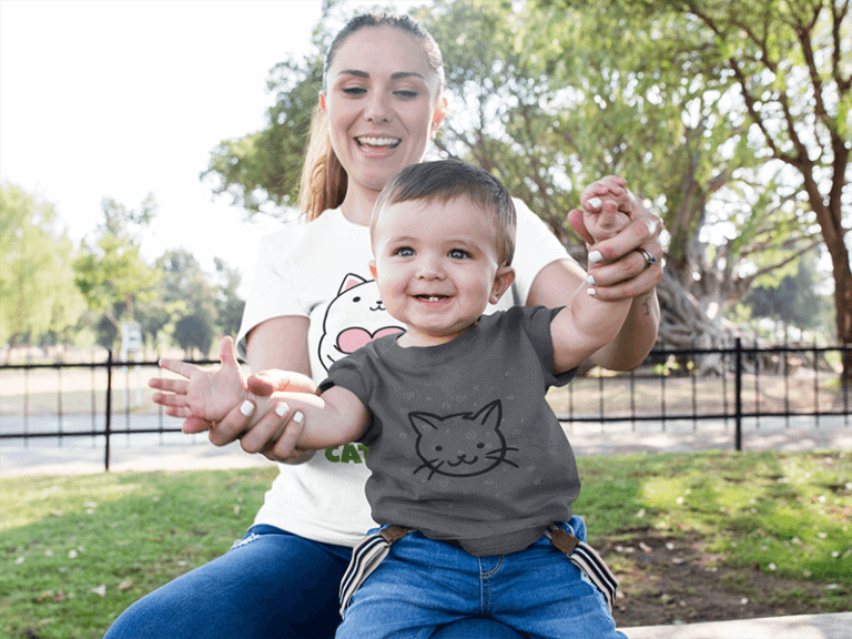 Mom And Her Baby Boy Playing In The Park While Wearing Different Round Neck Tees Mockup 16100 768x576