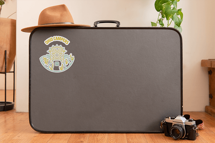 Sticker Mockup Featuring A Suitcase And Other Items