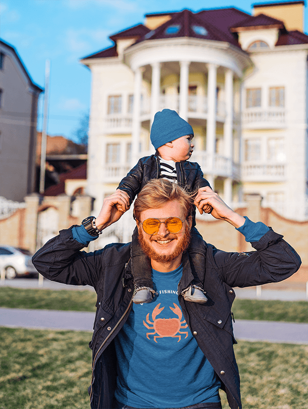 T Shirt Mockup Featuring A Smiling Dad Carrying His Baby On His Shoulders