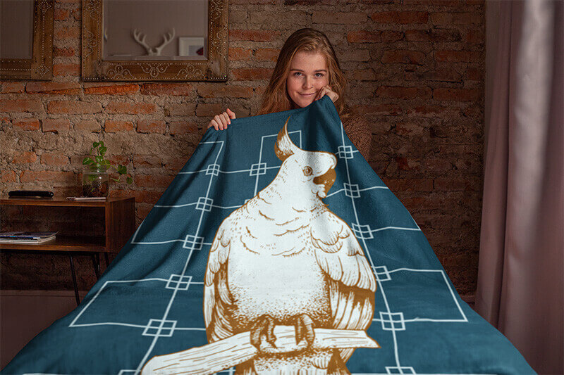 Throw Blanket Mockup Featuring A Girl Sitting On A Bed
