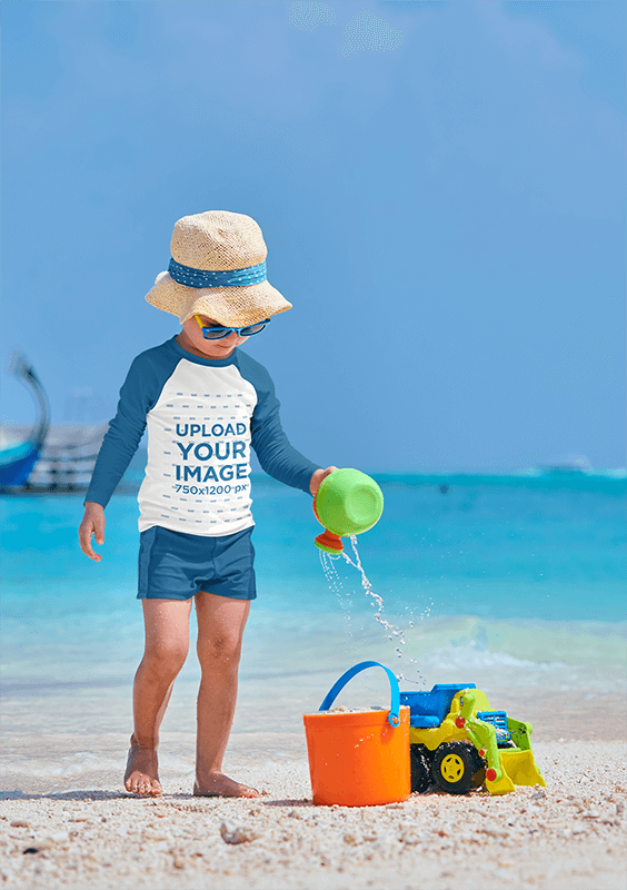 Mockup Of A Little Boy With A Raglan Long Sleeve Tee Playing In The Sand