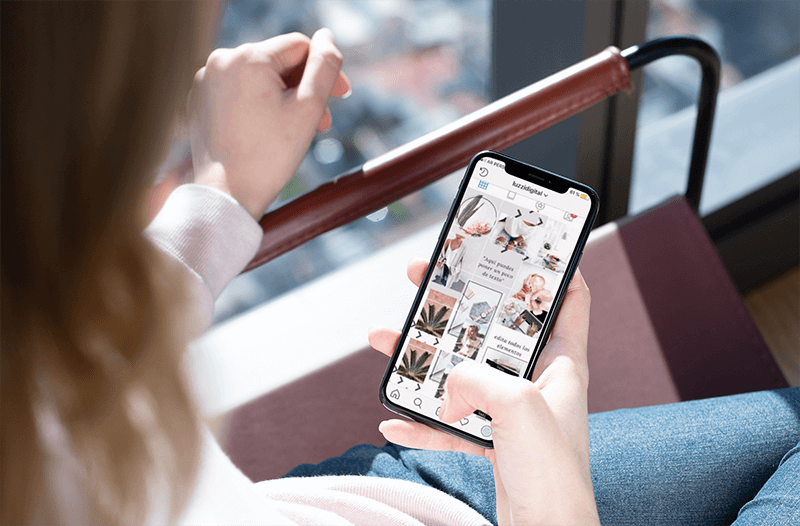 Over The Shoulder Iphone Xs Mockup Of A Girl Sitting On A Minimalist Chair