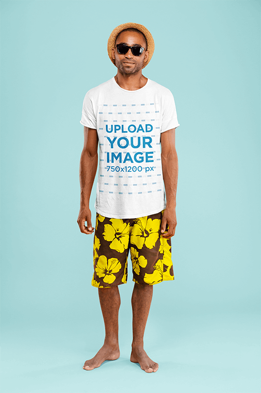 T Shirt Mockup Of A Man With A Beach Style Posing At A Studio